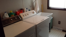 Washer and dryer on main level.